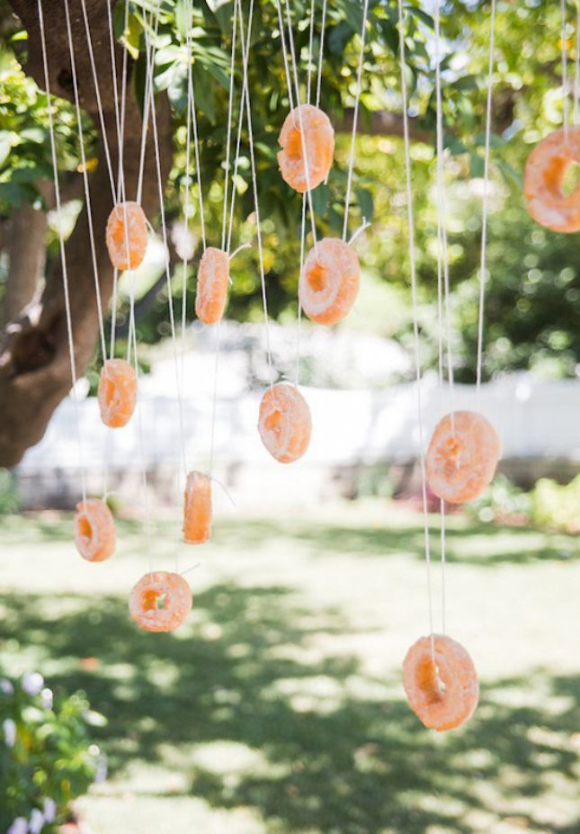 8 fall inspired wedding games that are sure to be a hit with the kids donut eating race junglespirit Choice Image