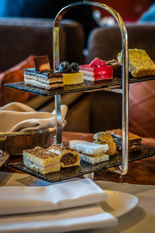 91122609 - three tier afternoon tea set and pastries