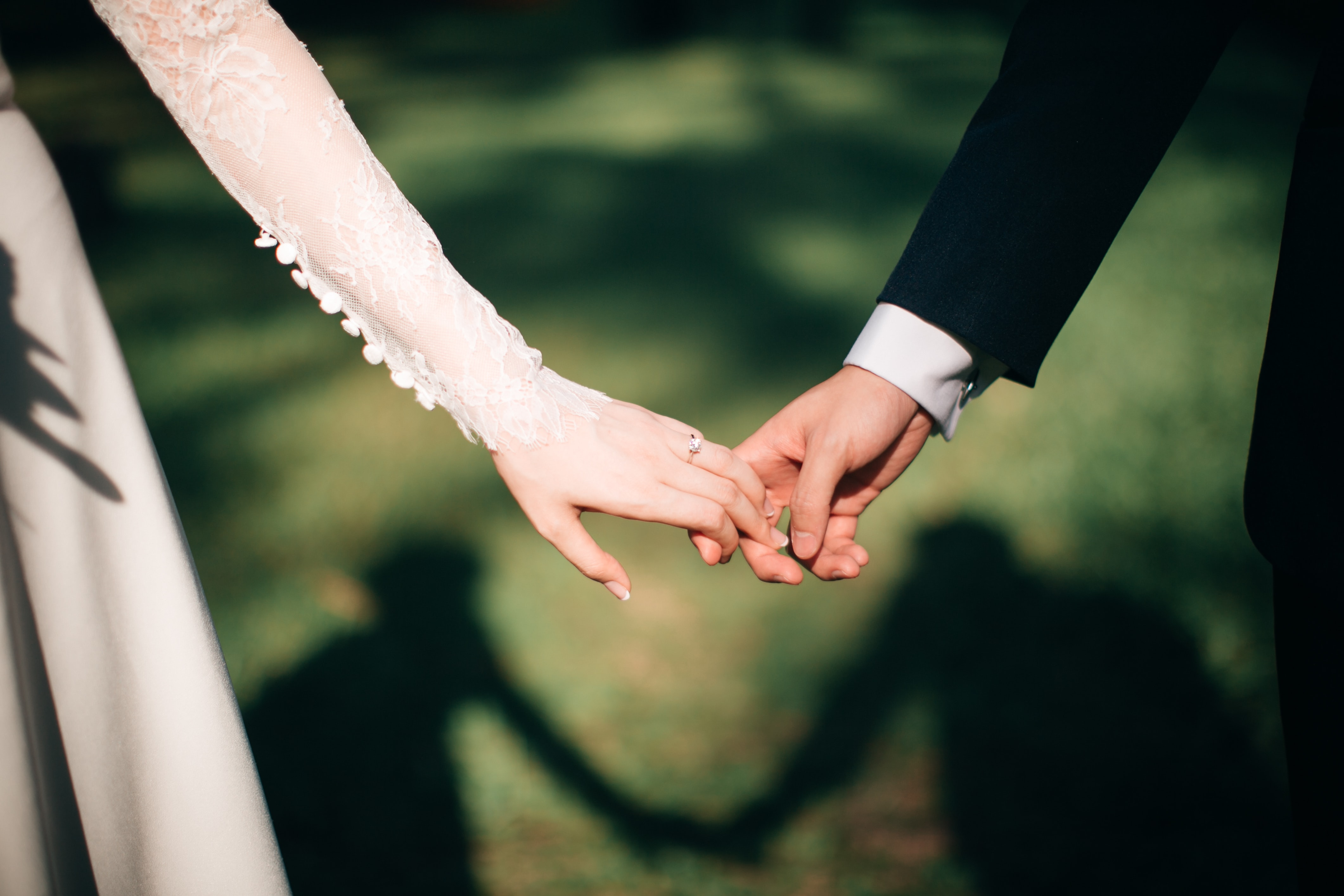 Wedding Season Finally Kicks off - couple holding hands